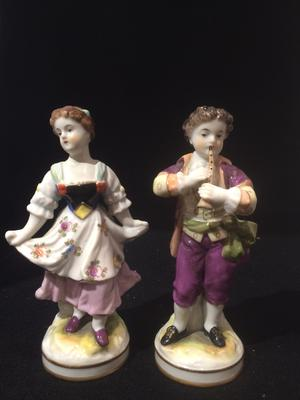 A Pair of Boy Girl Figurines with a 3 loops crown mark with a cross on top and two Gs one a backtofront mirror G
