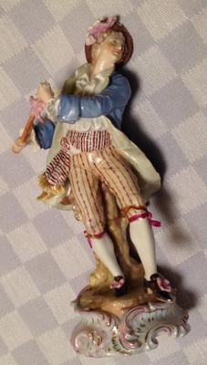 Male flute player dancing figurine