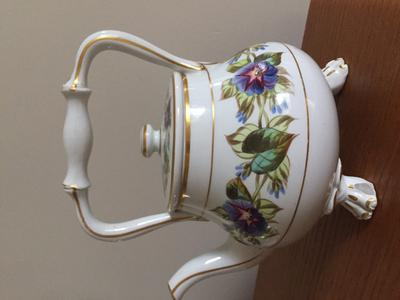 family heirloom unmarked teapot with ceramic handle
