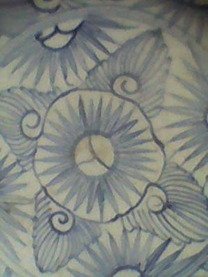 Hand painted geometric blue and white floral pattern on a bowl