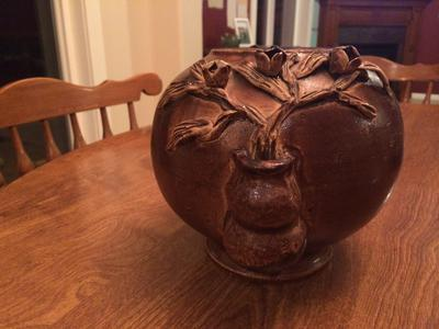 Old Round Brown pottery bowl with relief flower pots each side