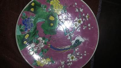 purple oriental plate with a pheasant, branches and lotus blossom foliage