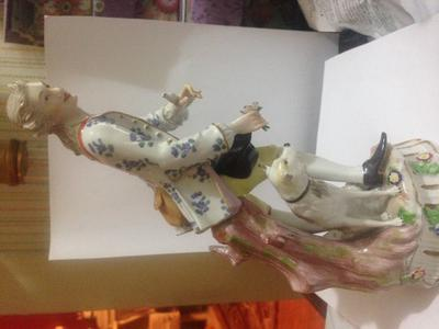 Porcelain figurine with a blue mark, crown over an H?