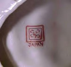"Pottery mark on cute vintage flower ceramic - backstamp is flower or a clover, with 2 squares around it (looks a bit like a picture frame) and the word ""Japan"" under"