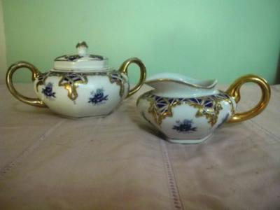 Tea Set with Blue Crown and ornate letters LS?