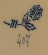 Flower with two leaves and three stripes marking on what looks like an Oriental plate please