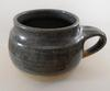 Nine-spoked wheel or a sunburst on Studio Pottery Mug