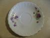 A saucer showing the violets pattern