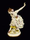 Curtseying German Figuine with arm aloft