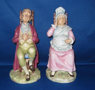 Two blue feathers mark of a pair of seated figurines, or possibly leaves conjoined at the stem