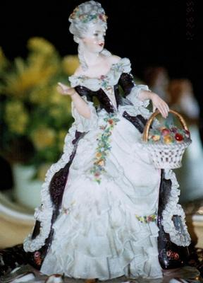 Two exquisite porcelain lace sisters with an