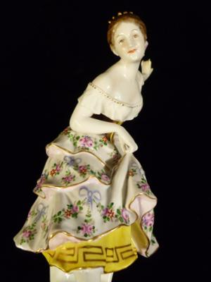 very nicely modelled figure of bowing girl