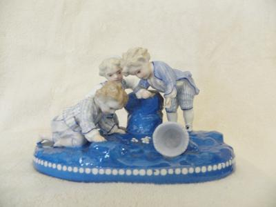 Anchor Mark Query - Boys Playing Marbles Figurine
