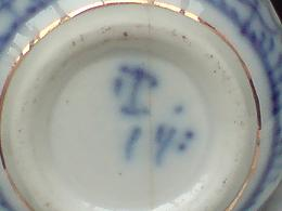 Porcelain Mark Query - What looks like a 'T' on Indian Asian(?) handwritten marking