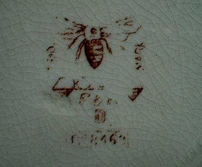 This is the backstamp - Bee with extended wings