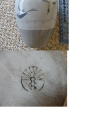 Pottery Mark Query - Sun burst rays with possible RC/RG/EC/EG?  two letters printed on top of each other