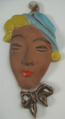 Terracotta Caribbean lady face wall plaque with pottery mark saying 'something... PORT'